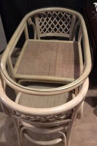 Wicker table w glass top and 2 chairs.