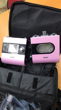 Pink and black canon point and shoot camera