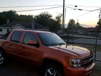 orange Chevrolet Silverado crew cab pickup truck Greensboro, 27405