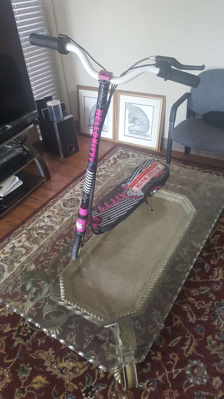 Photo Brand new never used Hello Kitty Electric scooter with 12-volt charger
