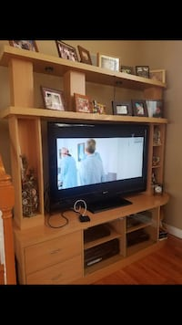 black flat screen TV with brown wooden TV hutch Baldwin Park, 91706