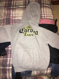 Gray and black the north face pullover hoodie Lower Sackville, B4E 1R2