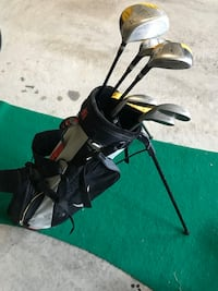 Junior golf clubs and bag stand