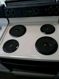 GE black and bisque coil range stove Tampa, 33604