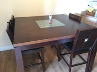 rectangular brown wooden table with four chairs dining set Bakersfield, 93305