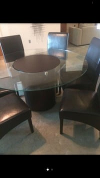brown wooden base clear glass top round dining table Tampa, 33602