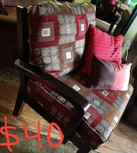 red, black, and brown fabric padded seat