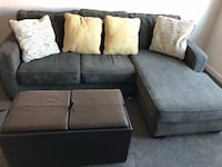 Gray fabric sectional sofa with throw pillows with table and 2 small chairs included inside. Arlington, 22204