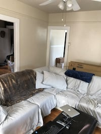 White leather sectional couch with covers and blankets  Sausalito, 94965
