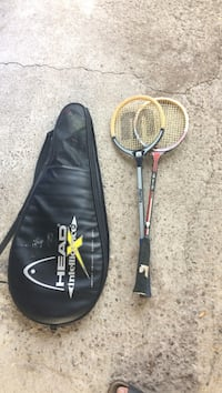 Two yellow-and-black head badminton rackets 556 km