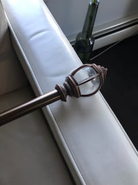 Bronze curtain rod and black suede black out curtains Edmonton