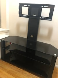 black glass-top TV stand with mount 367 km