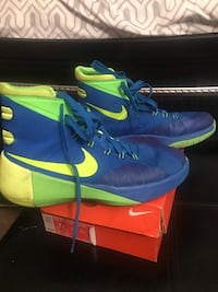 Pair of blue-and-green nike basketball shoes District Heights, 20747