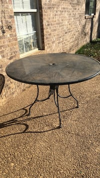 Round black metal outdoor table