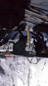 3 xbox guitars and drumset  Vergas, 56587