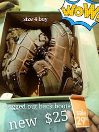 size 4 pair of brown leather hiking boots box Saginaw, 48602