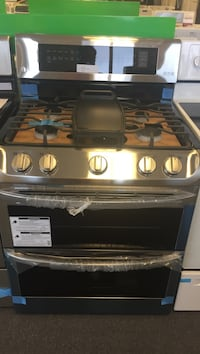 LG 30 inch freestanding gas range with fist burner and griddle comes with manufactures warranty available 8415 Coin Ave. open daily 10 eight Sunday 12 to 6 S for Lilly