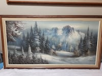 snowy pine trees and mountain painting with brown wooden frame