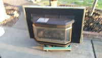 Gold and black gas insert fireplace  Roseville, 95678