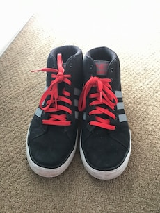Black-and-red Adidas high tops
