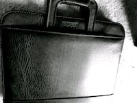 black leather  Buxton Data book St. Catharines, L2M 4G1