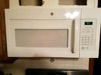 5 month old white General Electric microwave oven