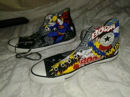 Converse all star Superman shoes.
