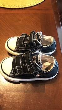 Pair of black-and-white shoes Converse one star Velcro straps 6c toddler size real nice pair Waldorf, 20601