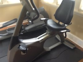 Black and gray recumbent stationary bike firm price
