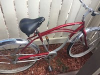 Red Schwinn Beach Cruiser bike Surprise, 85374