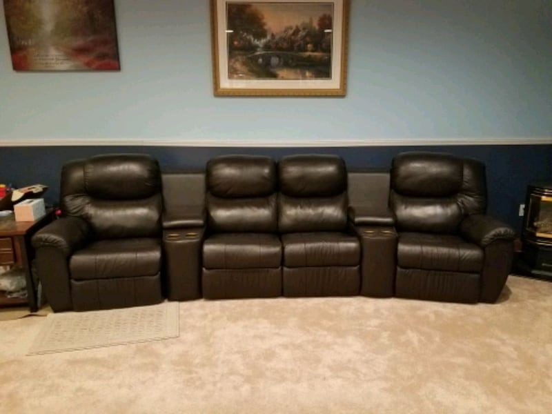 Leather stadium seating couch 3f55b2cb-6dad-4a2e-9f04-4a25cffed8e6
