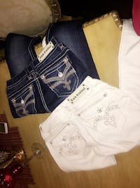 blue denim jeans and white and black polo shirt