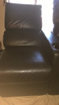 2 black leather reclining theater chairs.