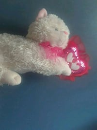 white and pink dog plush toy 22 mi