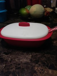 oval red and white plastic food container with lid 2269 mi
