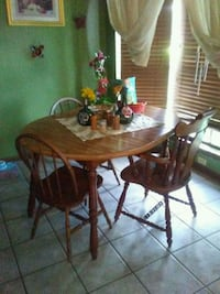 oval brown wooden table with four chairs dining set Semmes, 36575