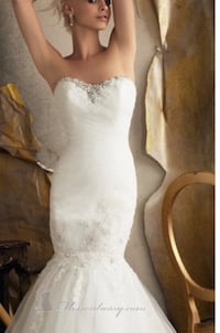 Women's white strapless wedding gown by Mori Lee. Comes with the detachable lace top and a long veil. The dress will require dry cleaning but it is in great condition. Aldie, 20105