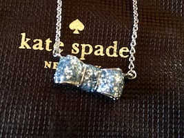 Silver-colored kate spade diamond encrusted bow pendant necklace