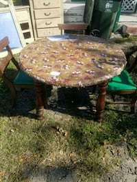round brown wooden table with chairs Corpus Christi, 78418