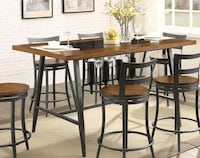 round brown wooden table with 6 chairs dining s Austin