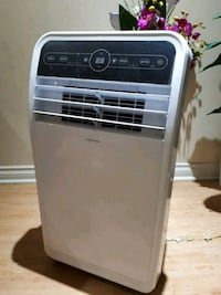 silver and black Insignia portable air cooler