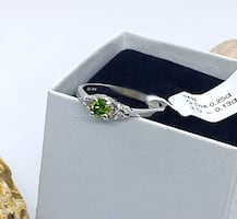 Silver and green gemstone ring