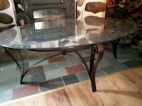 Oval glass top table with black metal base Sainte-Catherine, J5C 1Z7