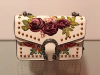 white, red, and pink floral leather clutch bag