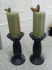 two black and green candles  lamps