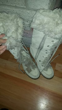 pair of white side-zip fur-line boots
