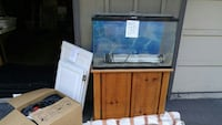 brown wooden framed clear glass fish tank