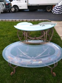 8 piece glass top tables set for inside or outside in a screen in room