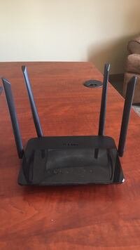 Black D-Link wireless modem router Whitby, L1R