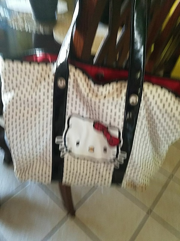white and black leather shoulder bag with Hello Kitty print